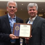 Tom McKee, with Dave Cuillier, collected Cincinnati's big award.