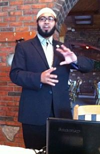 Faizan Syed speaks during media breakfast in St. Louis